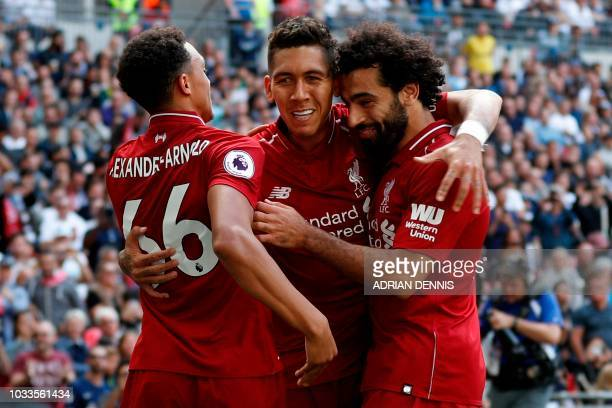 TOPSHOT Liverpool's Brazilian midfielder Roberto Firmino celebrates after scoring their second goal with Liverpool's English defender Trent...