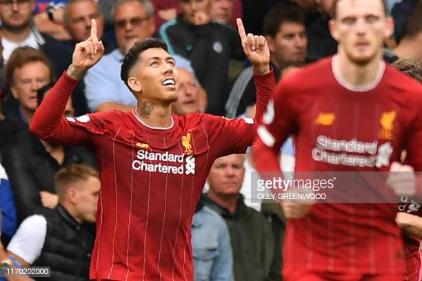 Liverpool's Brazilian midfielder Roberto Firmino celebrates after scoring their second goal during the English Premier League football match between...