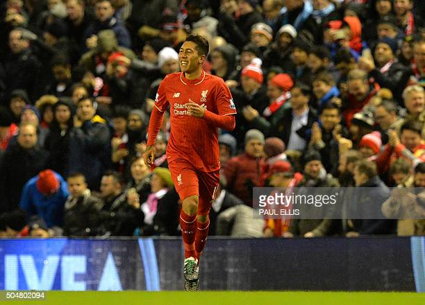 Liverpool's Brazilian midfielder Roberto Firmino celebrates after scoring during the English Premier League football match between Liverpool and...