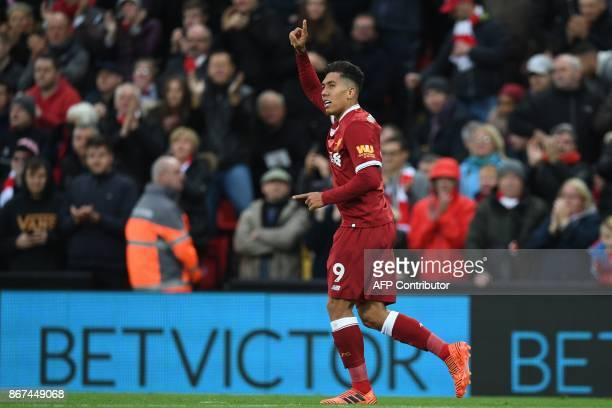 Liverpool's Brazilian midfielder Roberto Firmino celebrates after scoring their second goal with this header during the English Premier League...