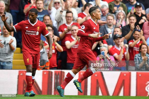 Liverpool's Brazilian midfielder Roberto Firmino celebrates after scoring the opening goal of the English Premier League football match between...