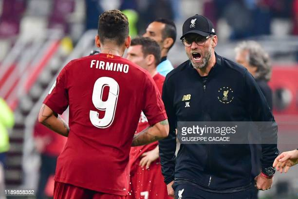 Liverpool's Brazilian midfielder Roberto Firmino celebrates his goal with Liverpool's German manager Jurgen Klopp during the 2019 FIFA Club World Cup...