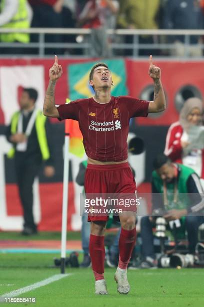 Liverpool's Brazilian midfielder Roberto Firmino celebrates his goal during the 2019 FIFA Club World Cup Final football match between England's...