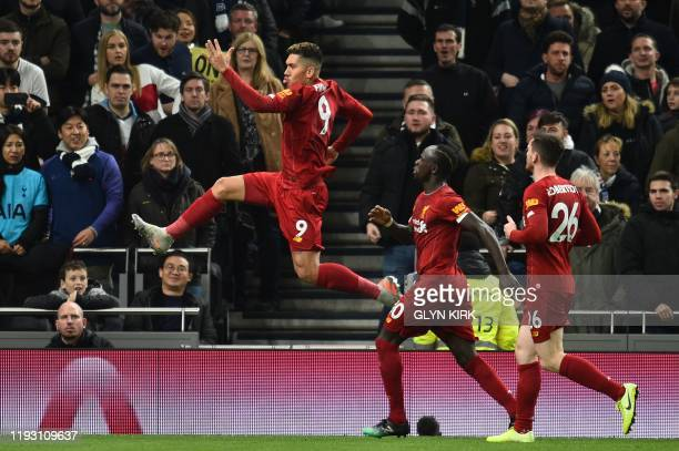 Liverpool's Brazilian midfielder Roberto Firmino celebrates scoring the opening goal during the English Premier League football match between...
