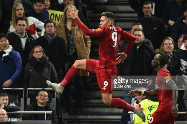 Liverpool's Brazilian midfielder Roberto Firmino celebrates scoring the opening goal during the English Premier League football match between...