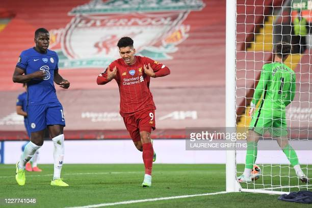 Liverpool's Brazilian midfielder Roberto Firmino celebrates scoring his team's fourth goal during the English Premier League football match between...