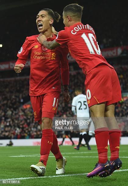 Liverpool's Brazilian midfielder Roberto Firmino celebrates scoring his team's fourth goal with Liverpool's Brazilian midfielder Philippe Coutinho...