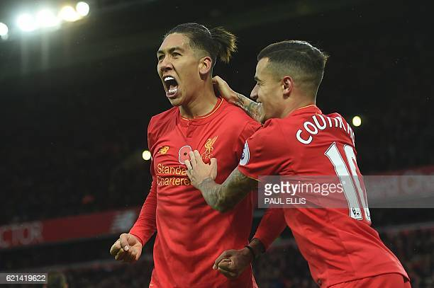 Liverpool's Brazilian midfielder Roberto Firmino celebrates scoring his team's fourth goal with Liverpool's Brazilian midfielder Philippe Coutinho...