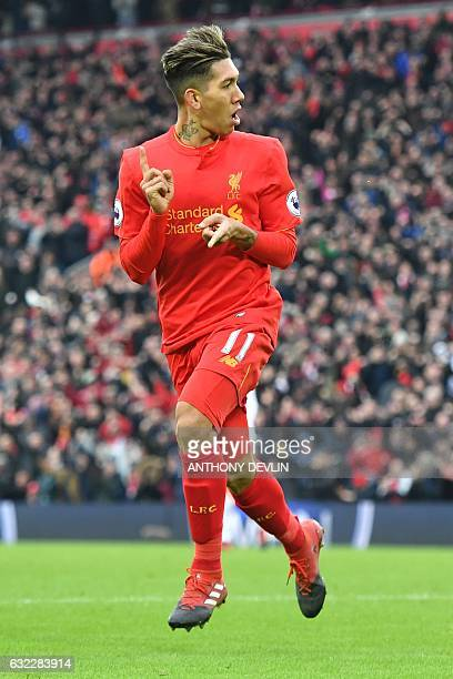 Liverpool's Brazilian midfielder Roberto Firmino celebrates scoring their second goal to equalise 22 during the English Premier League football match...