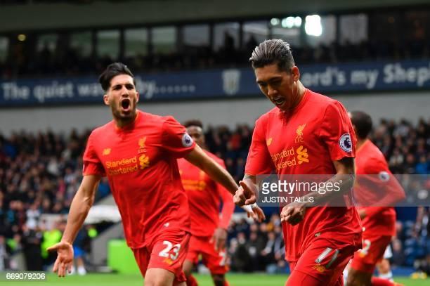 Liverpool's Brazilian midfielder Roberto Firmino celebrates scoring the opening goal with Liverpool's German midfielder Emre Can during the English...