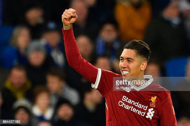 Liverpool's Brazilian midfielder Roberto Firmino celebrates scoring their third goal during the English Premier League football match between...