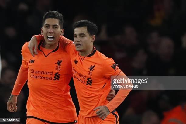 Liverpool's Brazilian midfielder Roberto Firmino celebrates scoring the team's third goal with Liverpool's Brazilian midfielder Philippe Coutinho...