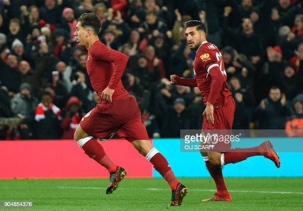 Liverpool's Brazilian midfielder Roberto Firmino celebrates scoring their second goal to take the lead 21 during the English Premier League football...