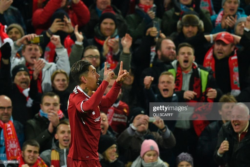 Liverpool's Brazilian midfielder Roberto Firmino celebrates scoring their second goal during the English Premier League football match between Liverpool and Manchester City at Anfield in Liverpool, north west England on January 14, 2018. / AFP PHOTO / Oli SCARFF / RESTRICTED TO EDITORIAL USE. No use with unauthorized audio, video, data, fixture lists, club/league logos or 'live' services. Online in-match use limited to 75 images, no video emulation. No use in betting, games or single club/league/player publications. /