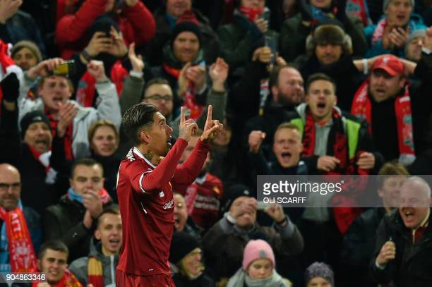 Liverpool's Brazilian midfielder Roberto Firmino celebrates scoring their second goal during the English Premier League football match between...