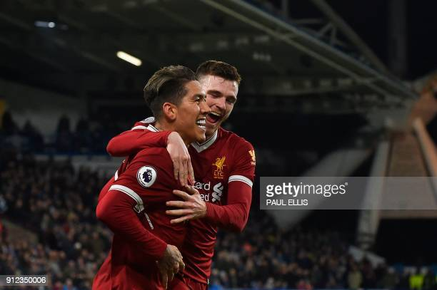 Liverpool's Brazilian midfielder Roberto Firmino celebrates scoring their second goal with Liverpool's Scottish defender Andrew Robertson during the...