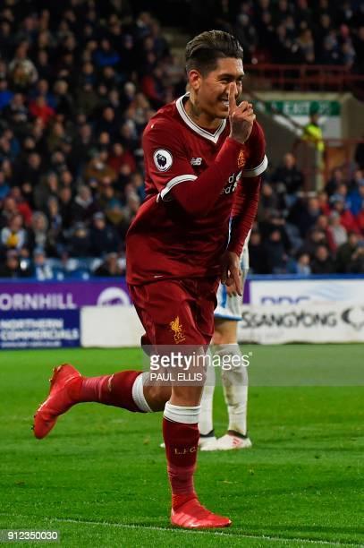 Liverpool's Brazilian midfielder Roberto Firmino celebrates scoring their second goal during the English Premier League football match between...