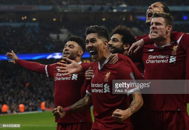TOPSHOT Liverpool's Brazilian midfielder Roberto Firmino celebrates scoring his team's second goal during the UEFA Champions League second leg...