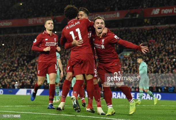 Liverpool's Brazilian midfielder Roberto Firmino celebrates shooting from the penalty spot to score his team's fifth goal during the English Premier...