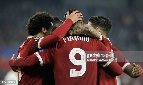 Liverpool's Brazilian midfielder Roberto Firmino celebrates with teammates after scoring a goal on November 21 2017 at the Ramon Sanchez Pizjuan...