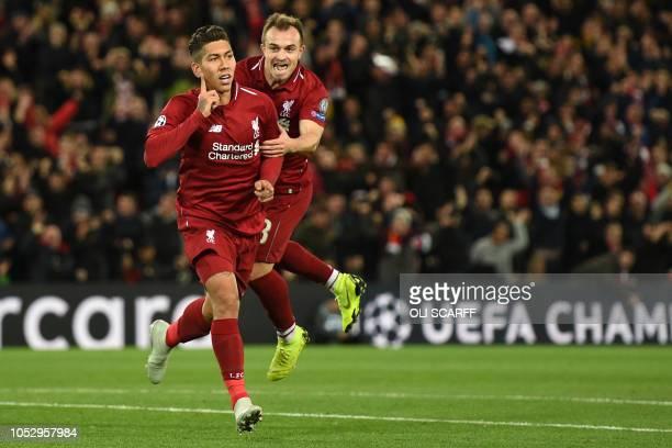 Liverpool's Brazilian midfielder Roberto Firmino celebrates with Liverpool's Swiss midfielder Xherdan Shaqiri after scoring the opening goal of the...