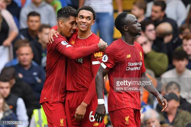 Liverpool's Brazilian midfielder Roberto Firmino celebrates with Liverpool's English defender Trent AlexanderArnold after scoring their second goal...