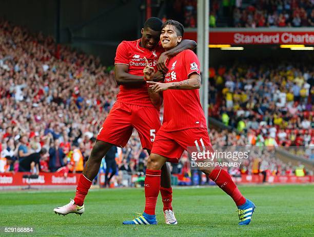 Liverpool's Brazilian midfielder Roberto Firmino celebrates with Liverpool's English midfielder Oluwaseyi Ojo after scoring his team's second goal...