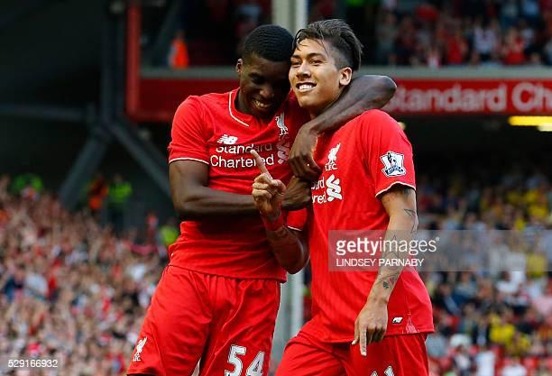 Liverpool's Brazilian midfielder Roberto Firmino celebrates with Liverpool's English midfielder Oluwaseyi Ojo after scoring his team's second goal...