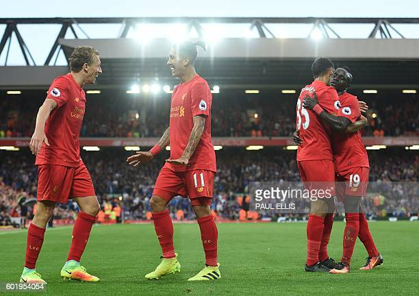 Liverpool's Brazilian midfielder Roberto Firmino celebrates with Liverpool's Brazilian midfielder Lucas Leiva as Liverpool's English defender Kevin...
