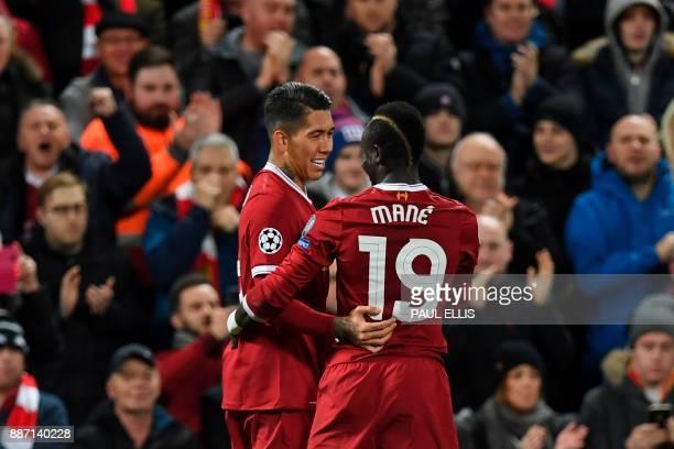 Liverpool's Brazilian midfielder Roberto Firmino celebrates with Liverpool's Senegalese midfielder Sadio Mane after Firmino scored their third goal...