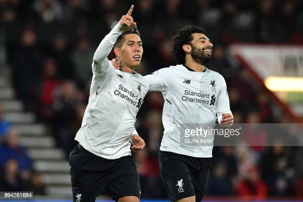 Liverpool's Brazilian midfielder Roberto Firmino celebrates with Liverpool's Egyptian midfielder Mohamed Salah after scoring their fourth goal during...