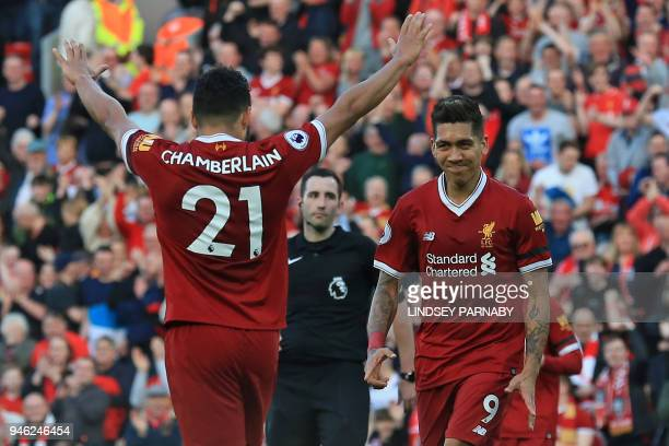 Liverpool's Brazilian midfielder Roberto Firmino celebrates with Liverpool's English midfielder Alex OxladeChamberlain after scoring their third goal...