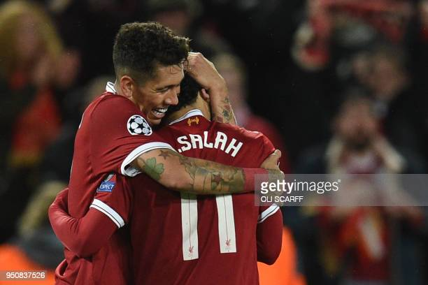 TOPSHOT Liverpool's Brazilian midfielder Roberto Firmino celebrates with Liverpool's Egyptian midfielder Mohamed Salah after scoring their fourth...