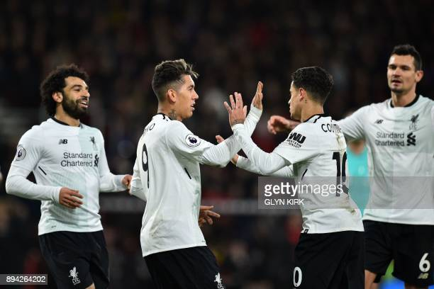 Liverpool's Brazilian midfielder Roberto Firmino celebrates with the game's other goalscoreres Liverpool's Egyptian midfielder Mohamed Salah...