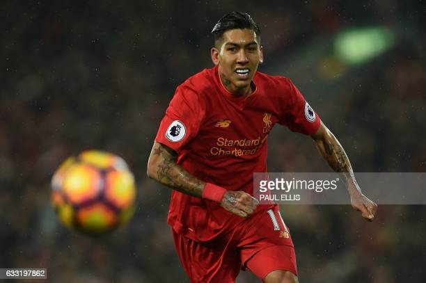 Liverpool's Brazilian midfielder Roberto Firmino chanses the ball during the English Premier League football match between Liverpool and Chelsea at...