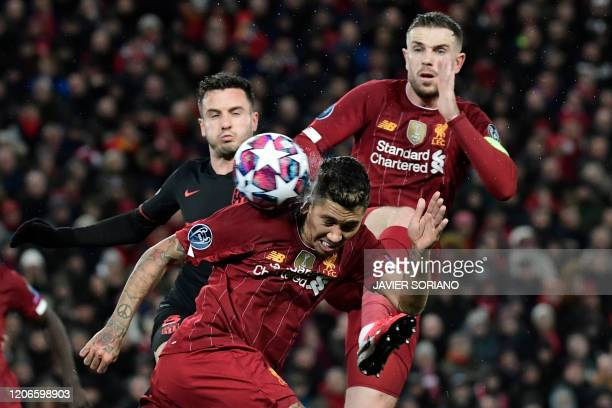 TOPSHOT Liverpool's Brazilian midfielder Roberto Firmino controls the ball during the UEFA Champions league Round of 16 second leg football match...