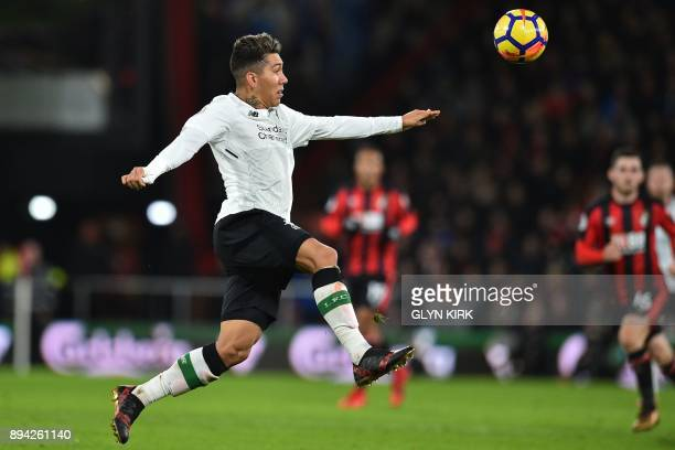 Liverpool's Brazilian midfielder Roberto Firmino controls the ball during the English Premier League football match between Bournemouth and Liverpool...