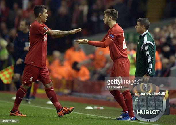 Liverpool's Brazilian midfielder Roberto Firmino is replaced by Liverpool's English midfielder Adam Lallana during a UEFA Europa League group B...