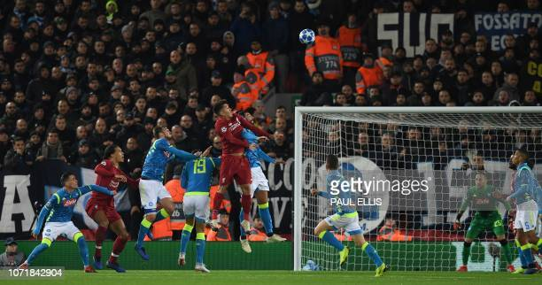 Liverpool's Brazilian midfielder Roberto Firmino jumps to head the ball during the UEFA Champions League group C football match between Liverpool and...