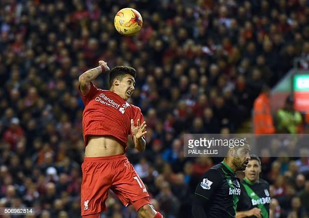 Liverpool's Brazilian midfielder Roberto Firmino jumps to make a header during the English League Cup semifinal second leg football match between...