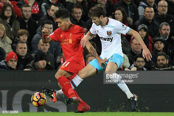 Liverpool's Brazilian midfielder Roberto Firmino L0 vies with West Ham United's Norwegian midfielder Havard Nordtveit during the English Premier...