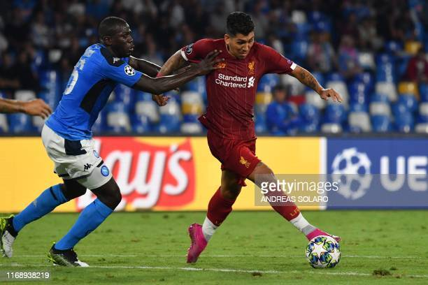 Liverpool's Brazilian midfielder Roberto Firmino outruns Napoli's Senegalese defender Kalidou Koulibaly during the UEFA Champions League Group E...