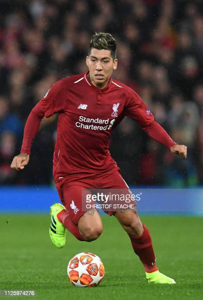 Liverpool's Brazilian midfielder Roberto Firmino plays the ball during the UEFA Champions League round of 16 first leg football match between...