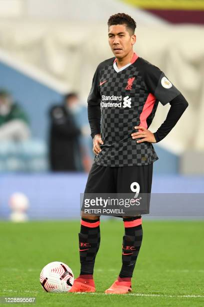 Liverpool's Brazilian midfielder Roberto Firmino prepares to kick off with the score at 5-1 during the English Premier League football match between...