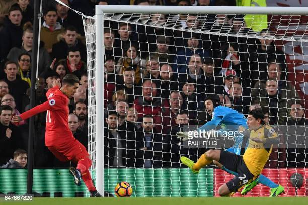 Liverpool's Brazilian midfielder Roberto Firmino prepares to shoot past Arsenal's Czech goalkeeper Petr Cech to score the opening goal of the English...