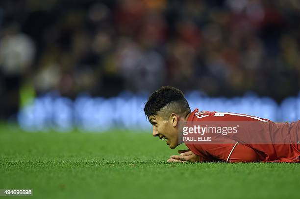 Liverpool's Brazilian midfielder Roberto Firmino reacts after having his shot on goal saved during the English League Cup fourth round football match...