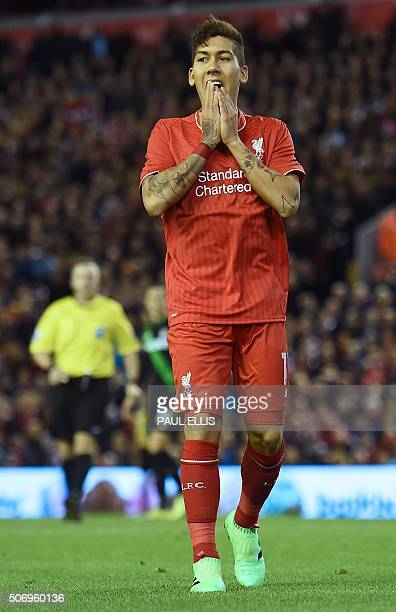 Liverpool's Brazilian midfielder Roberto Firmino reacts after missing a chance during the English League Cup semifinal second leg football match...