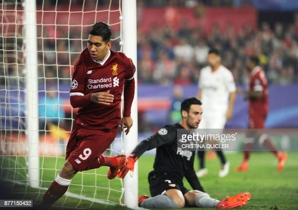 Liverpool's Brazilian midfielder Roberto Firmino reacts after scoring a goal on November 21 2017 at the Ramon Sanchez Pizjuan stadium in Sevilla...