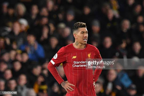 Liverpool's Brazilian midfielder Roberto Firmino reacts after Watford's Senegalese midfielder Ismaila Sarr scores his team's second goal during the...