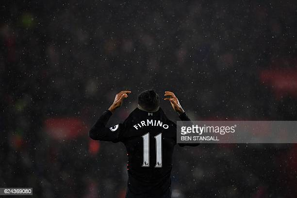 Liverpool's Brazilian midfielder Roberto Firmino reacts at the final whistle during the English Premier League football match between Southampton and...